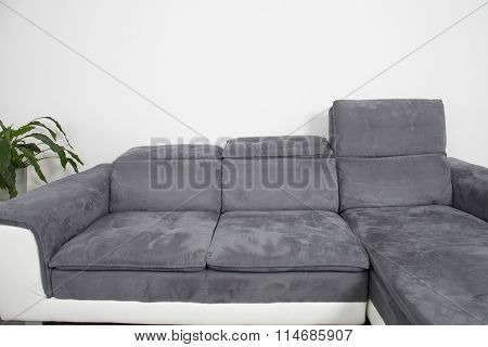 Beautiful Sofa In Grey, With Flowers In Contemporary Setting In Sumptuous Style Home.