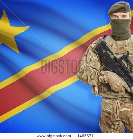Soldier Holding Machine Gun With Flag On Background Series - Congo-kinshasa