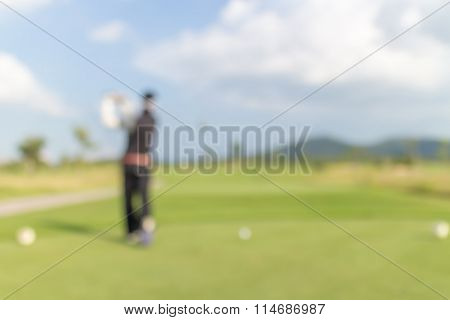 Blurred Photo Of Golf Player On Green During Golf Match.