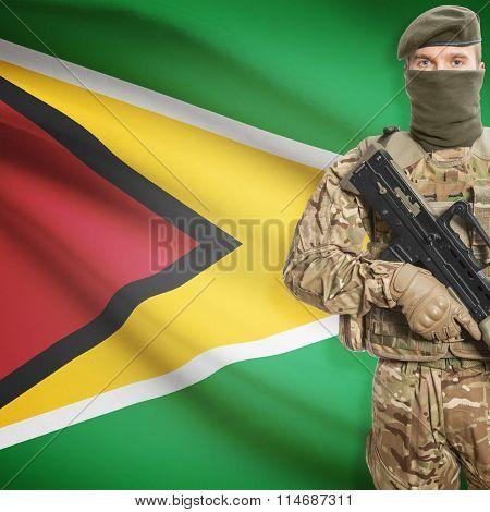 Soldier Holding Machine Gun With Flag On Background Series - Guyana