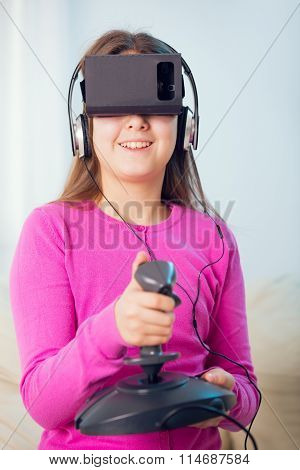 Young beautiful young girl holding a gaming computer wheel getting experience using VR-headset