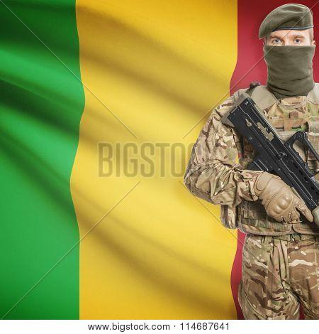 Soldier Holding Machine Gun With Flag On Background Series - Mali