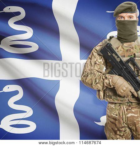 Soldier Holding Machine Gun With Flag On Background Series - Martinique