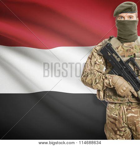 Soldier Holding Machine Gun With Flag On Background Series - Yemen