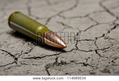 Kalashnikov Bullet On Desert Land Background