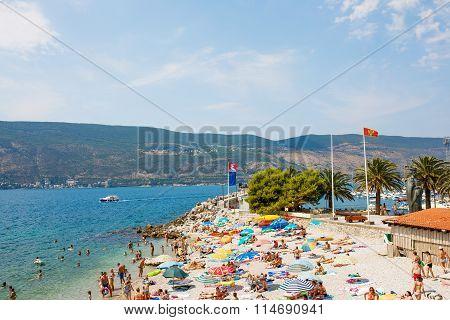 Herceg Novi, Montenegro - 12 August, 2015: People sunbathing and swimming at Herceg Novi Beach, Mont