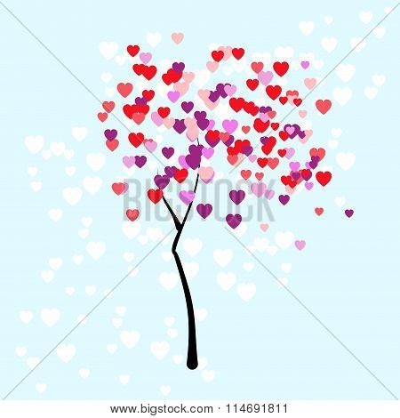 Stylised young tree on the pale blue background with leaves in the form of colorful small hearts