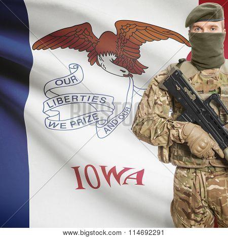 Soldier Holding Machine Gun With Usa State Flag On Background Series - Iowa