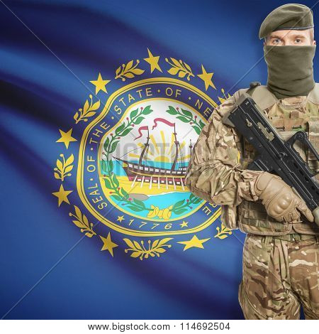 Soldier Holding Machine Gun With Usa State Flag On Background Series - New Hampshire
