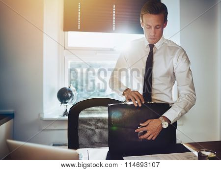 Business Man With Briefcase At Office