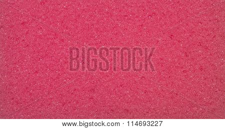 Red porous texture. The texture of the sponge. Closeup