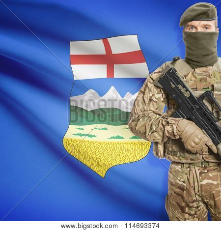 Soldier Holding Machine Gun With Canadian Province Flag On Background Series - Alberta