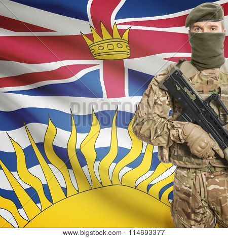 Soldier Holding Machine Gun With Canadian Province Flag On Background Series - British Columbia
