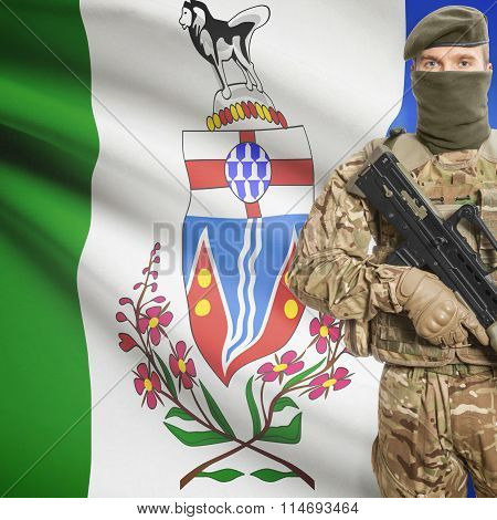 Soldier Holding Machine Gun With Canadian Province Flag On Background Series - Yukon