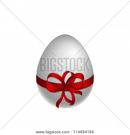 Paschal white egg with red bow and ribbon