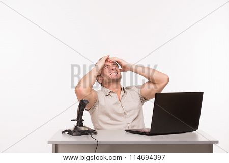 Handsome man playing computer games