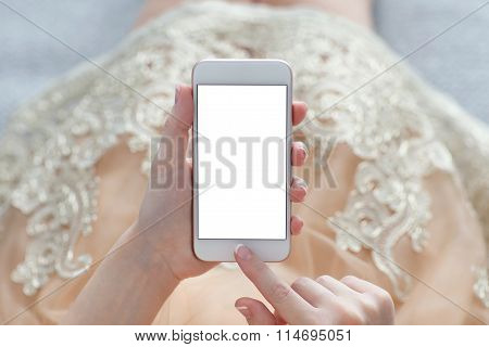Woman In A Gold Dress Holding Phone With Isolated Screen