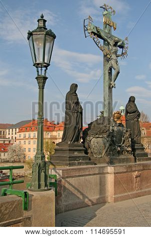 Prague, Czech Republic - April 18, 2010: Statuary Of The Holy Crucifix And Calvary On Charles Bridge