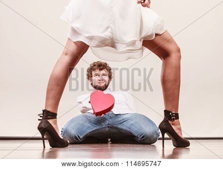 Man With Heart Shaped Gift Box For Woman.