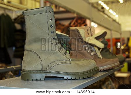 Army boots on the counter. Ammunition