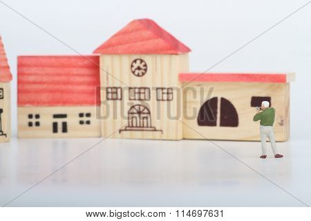 miniature of a photographer taking architectural pictures