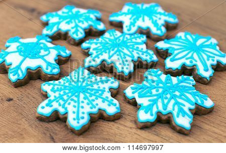Snowflake Shaped Cookies On The Wooden Table Top.