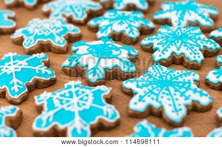 Many Snowflake Shaped Cookies On The Wooden Table Top.