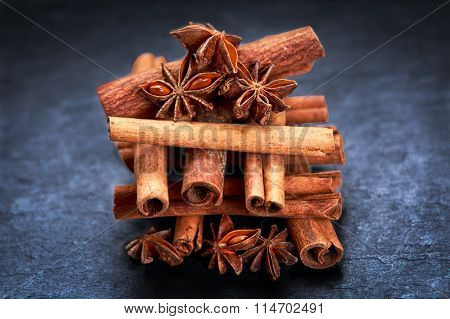 Cinnamon Sticks And Anice On Blue Stone Background. Selected Focus