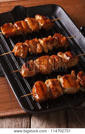 Japanese Yakitori Skewers Of Chicken On A Grill. Vertical Close-up