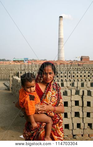 SARBERIA - JANUARY 16: The workers live with their families within the brick factory, where they work and live in inhuman conditions on January 16, 2009 in Sarberia, West Bengal, India.