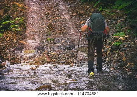 Young Man with backpack hiking outdoor Travel Lifestyle