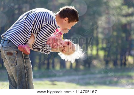 Father Holding Little Laughing Child