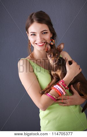 Girl with a dog on grey background