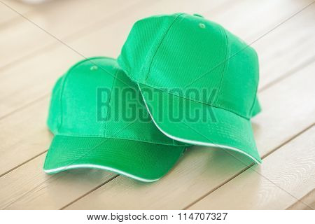 Two Green Baseball Caps