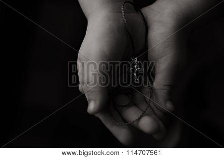 Orthodox Cross In Child's Hand