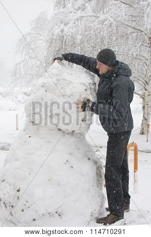 Tall Man Making Really Tall Snowman