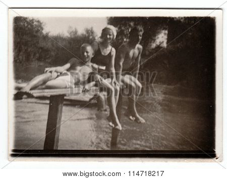 Vintage photo shows people who have a rest during summer holiday
