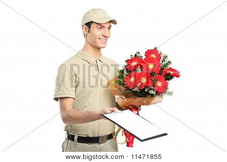 A Delivery Person Holding A Beautiful Bouquet