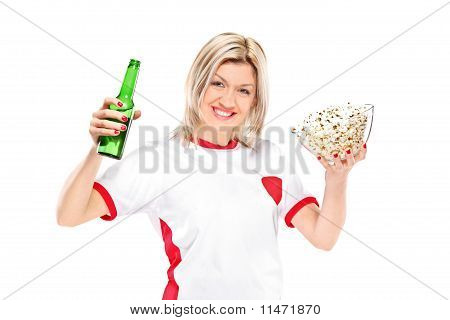 Female Sport Fan With A Beer Bottle And Popcorn Bowl In Her Hands