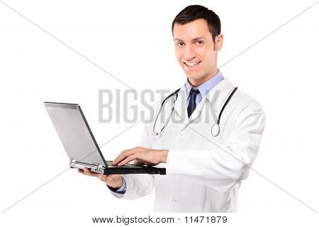 Smiling Doctor With Stethoscope Working On A Laptop