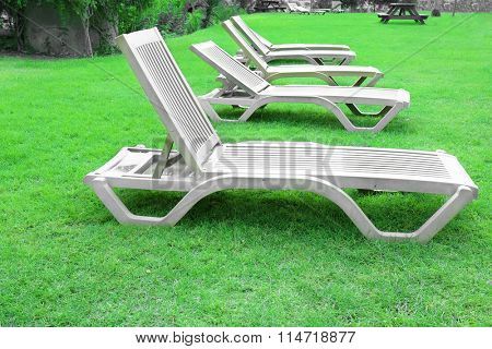 Chaise longue on the grass