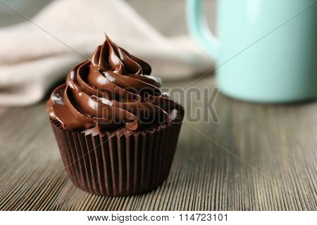 Chocolate cupcakes with drink on table