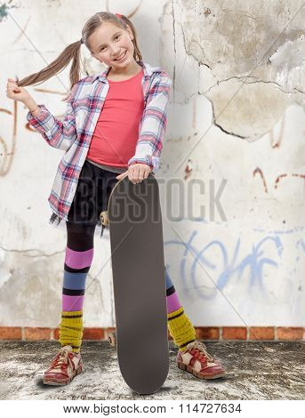 Pretty Little Girl With Skateboard, Old Wall Background