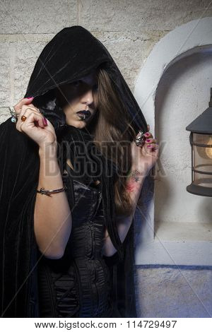 goth, young beautiful gothic girl with black lace dress and dark black cape