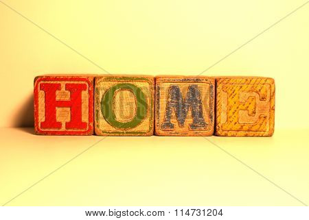Old building blocks spelling home