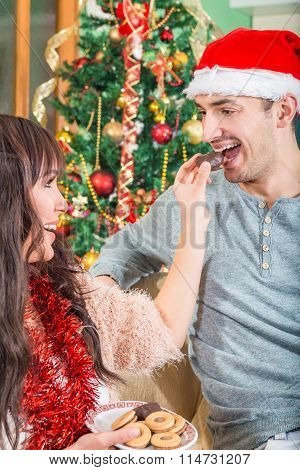 Woman Feeding A Man With Sweet Cookies Or Cake From A Plate