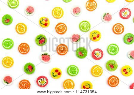 many differnt tasty candies on white