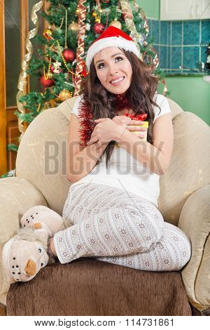 Picture Of Cheerful Santa Helper Girl With Gift Box Enjoying