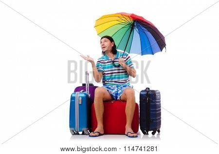 Traveler with cases and umbrella isolated on white