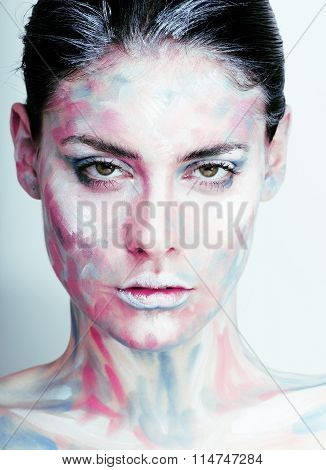 young woman with creative make up like painted oil picture on face